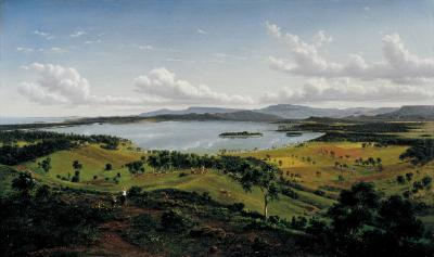 View of Lake Illawarra with distant mountains of Kiama